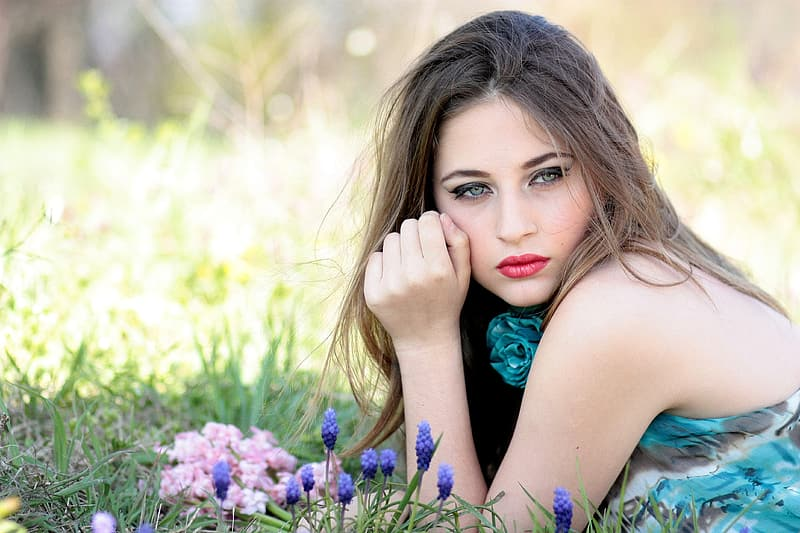 Woman wearing floral tank top on grass