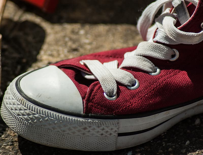 Unpaired red Converse All-Star high-top sneaker