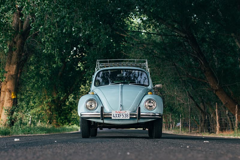 White volkswagen beetle on road during daytime