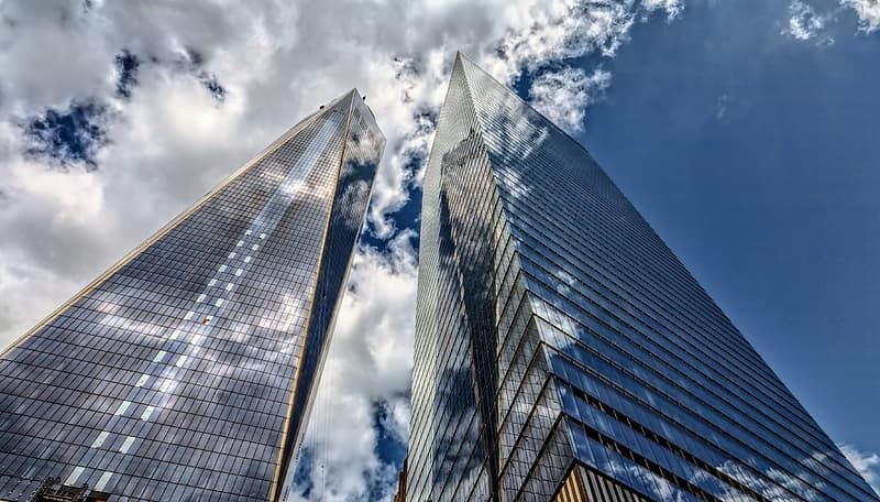 Low angle photography of high rise building under blue sky during daytime