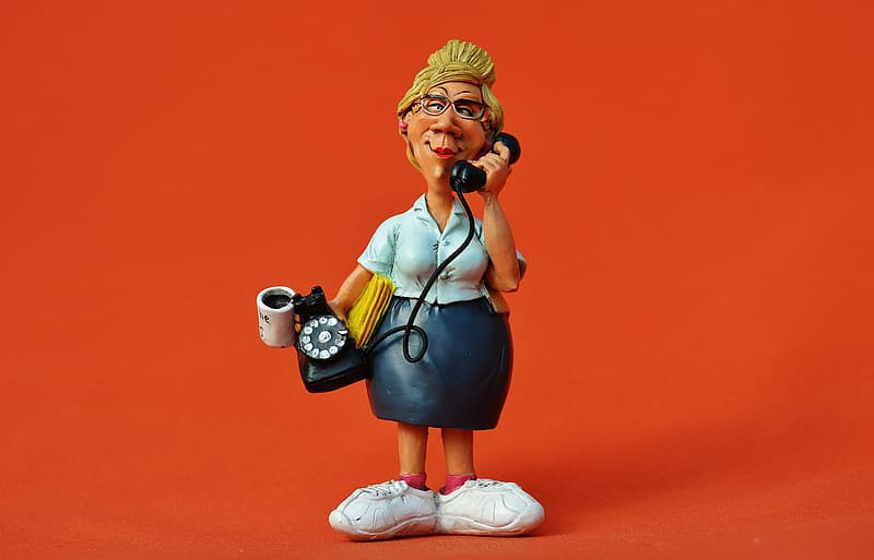 Woman holding rotary telephone figurine