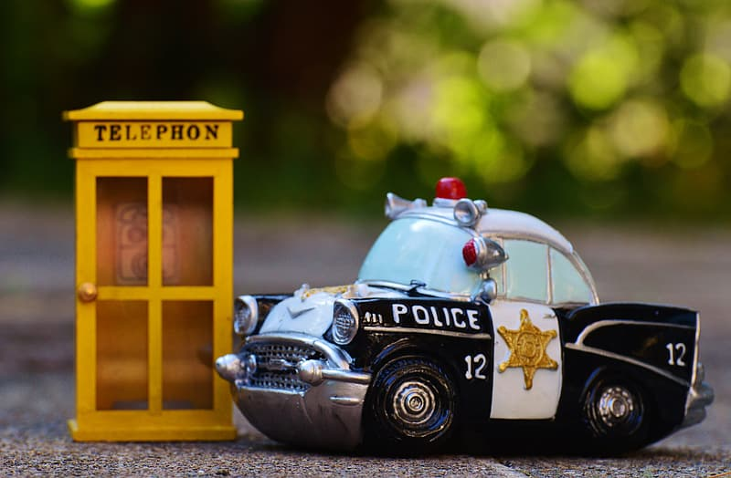 Black and yellow police car scale model