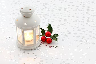 White tealight candle in candle lantern