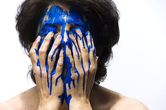 Person make face blue paint