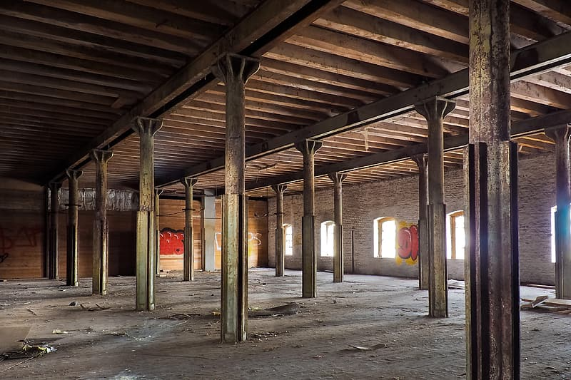Empty warehouse with rusted metal posts