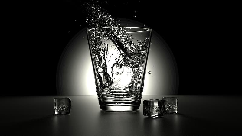 Clear drinking glass with water splash