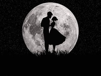 Silhouette of man and woman standing on black surface under moon