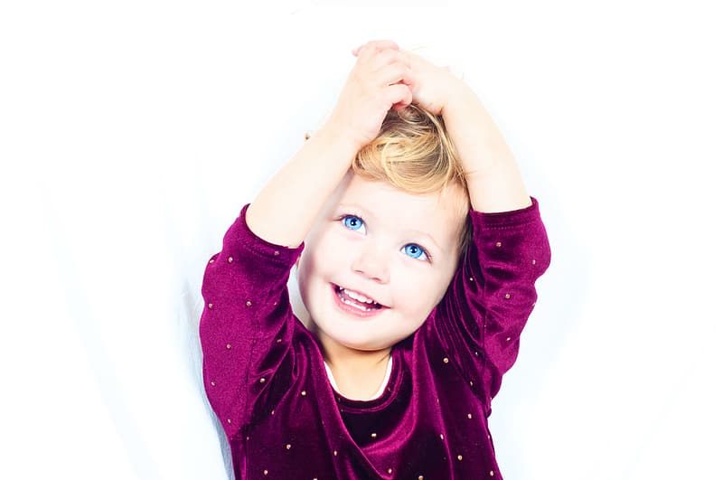 Child in purple 3/4-sleeved shirt