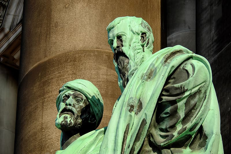 Close-up photography of two man wearing green suit statue