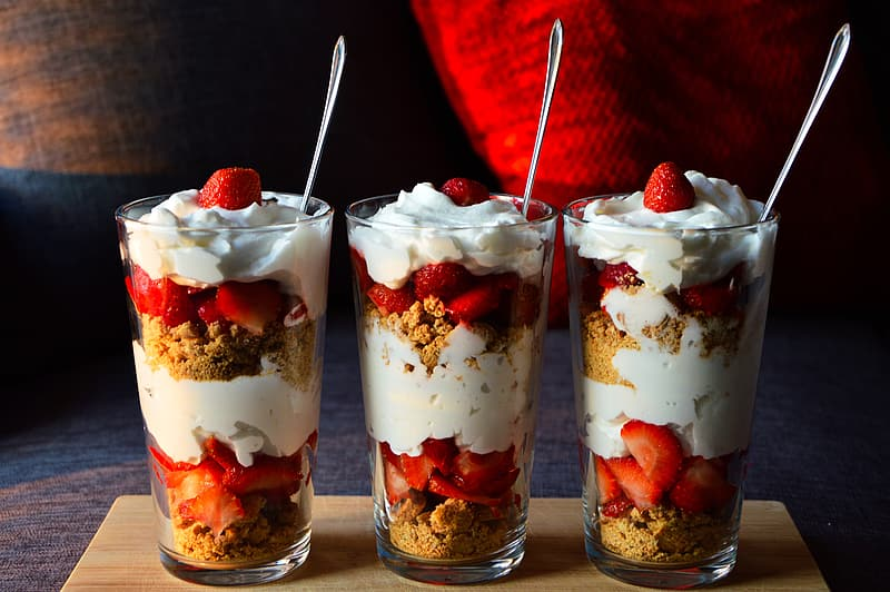 Three set of strawberries with whip creams