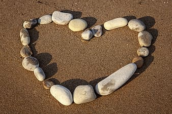 White and gray stones on brown sand