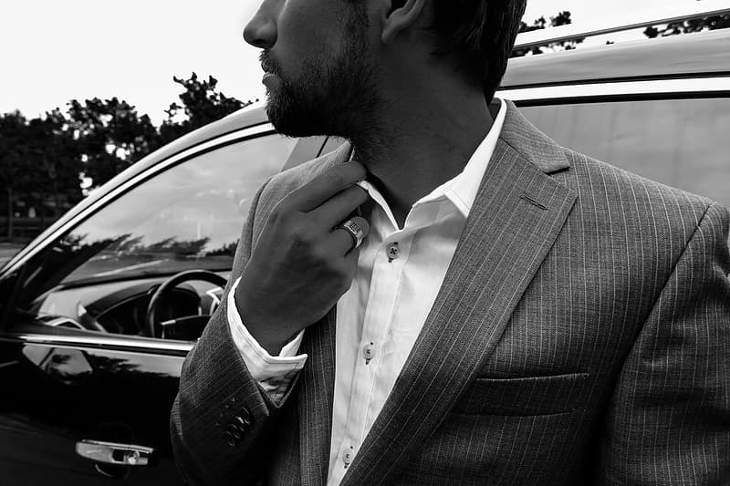Grayscale photography of man wearing formal suit