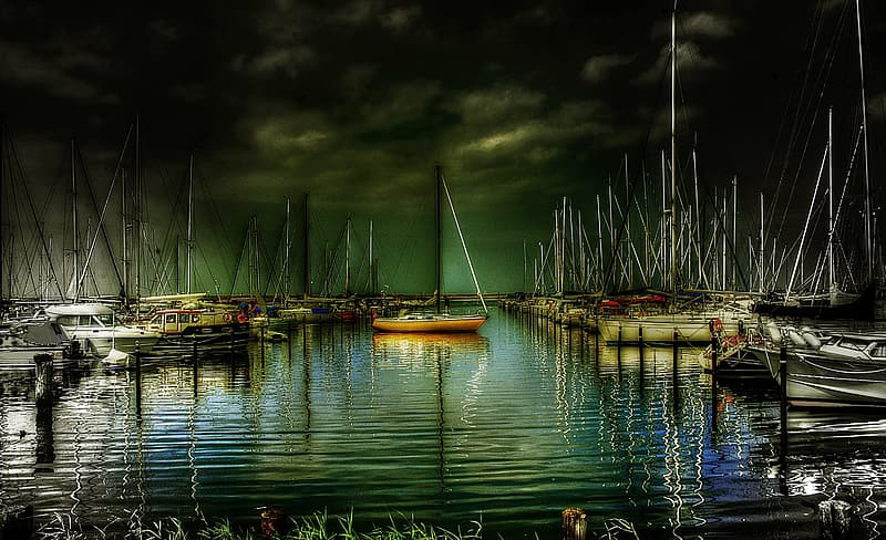 Assorted sailboat during nightime