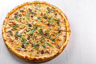 Pizza with herbs on top