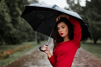 Shallow focus photography of woman wearing red long-sleeved shirt