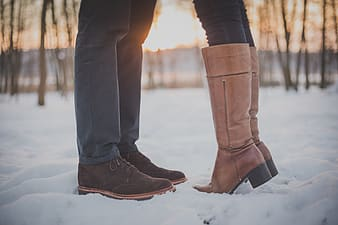Two persons standing on snow-covered ground