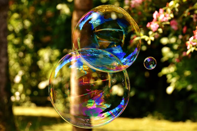 Selective focus photography of three bubbles during day time