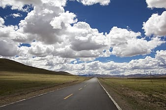 Concrete highway with mountains in distance