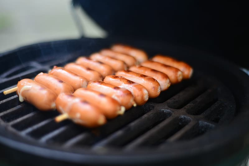 Sausage on black charcoal grill