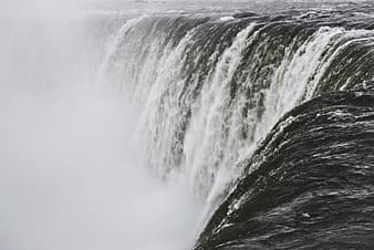 Water falls in close up photography