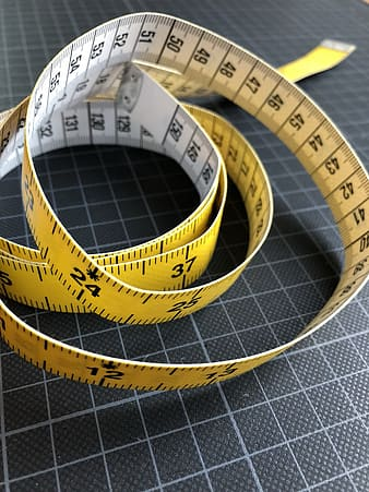 Yellow and white tape measure