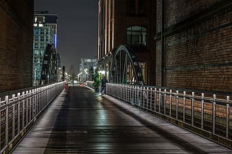 Bridge near building during nighttime