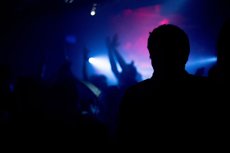 Silhouette of man standing in front of crowd