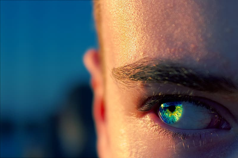 Person with blue and green eyes