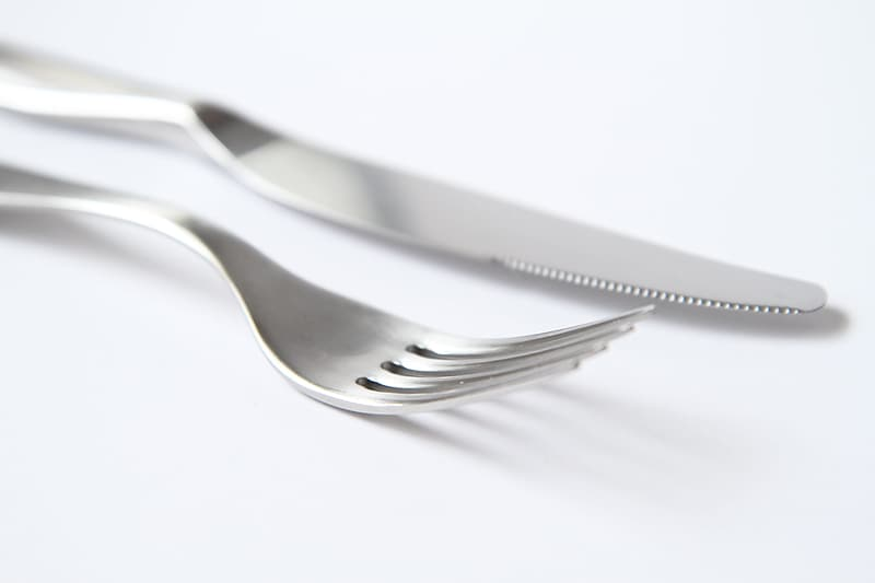 Gray stainless steel fork and bread knife