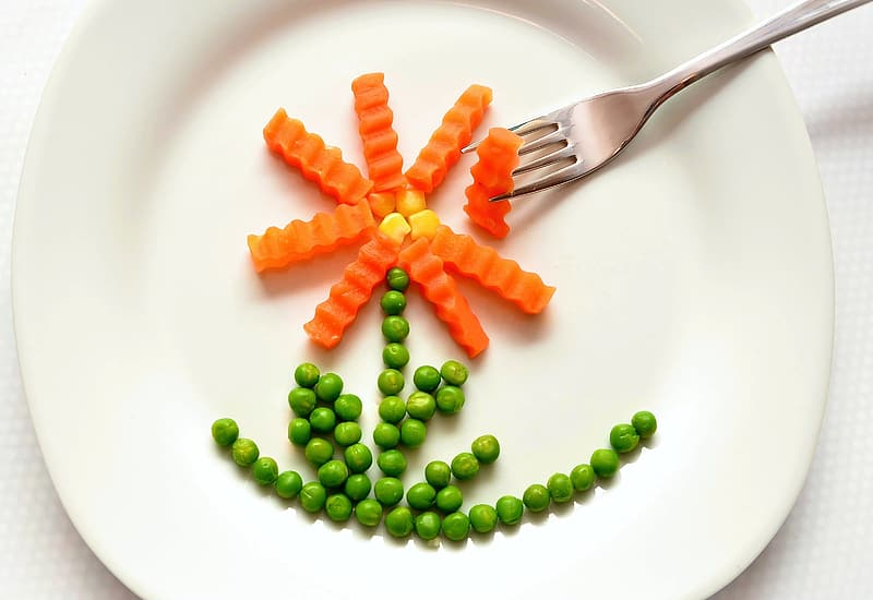 Plate of sliced carrots and green beans