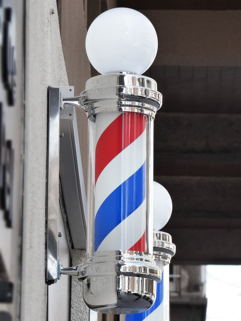 Turned-off red, blue, and white barbershop light