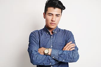 Man in blue chambray long-sleeve shirt with gold-colored round watch
