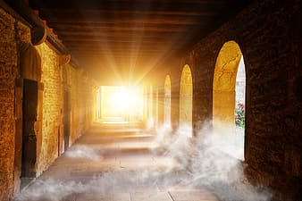 Light shining in brown concrete temple at daytime