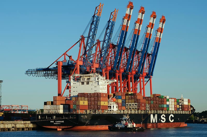 Blue and red cargo ship