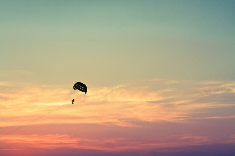 Person in parachute during sunset