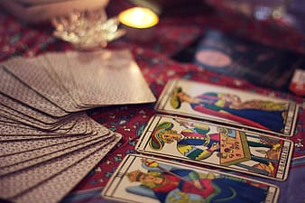 Tarot cards on red floral textile