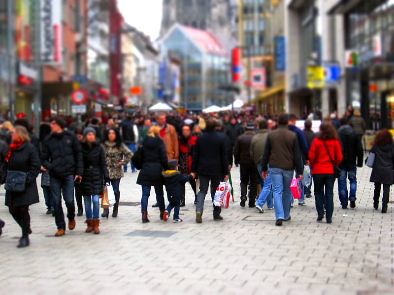 Group of people walking on street with bokeh effect