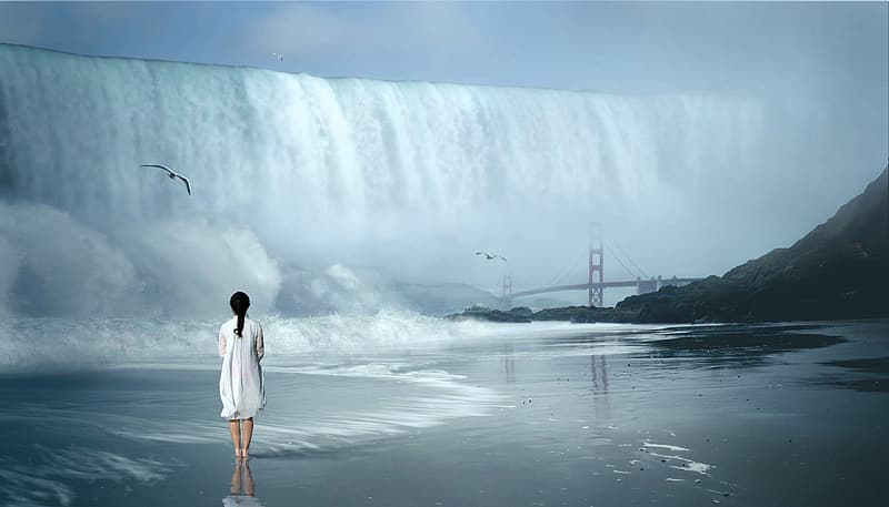 Woman standing next to water falls