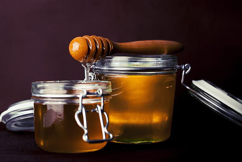 Honey on clear glass canister