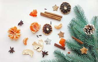 Flat lay photography of cinnamon sticks with star anise and peeled orange