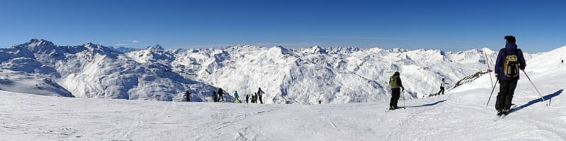Two person skiing on snow covered mountain