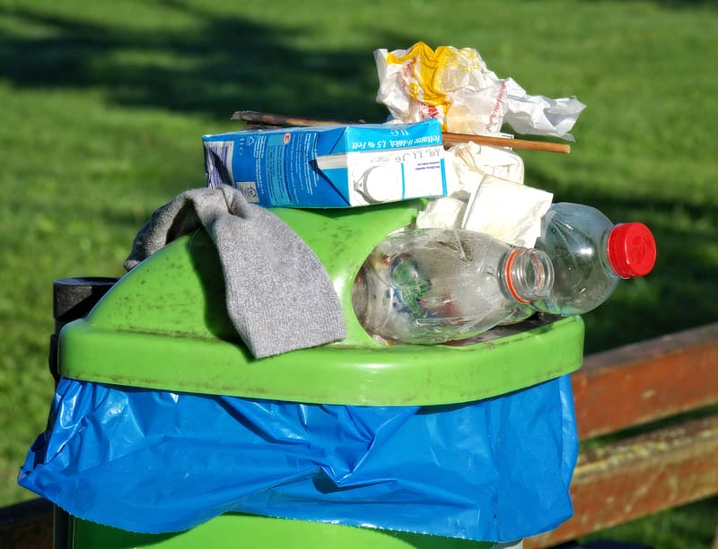 Plastic bottles and blue tetra pack on dustbin