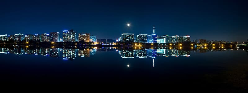 Body of water near building at nighttime