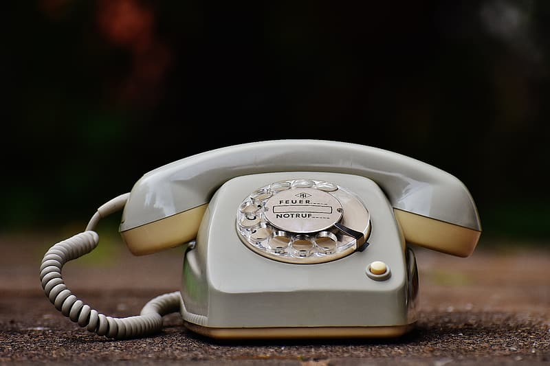 Selective focus photography of rotary telephone