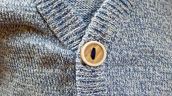 Buttoned blue fabric apparel closeup photro