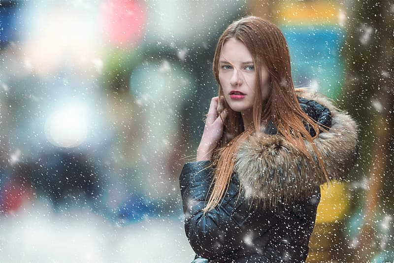 Selective photography of woman in black and brown parka hoodie