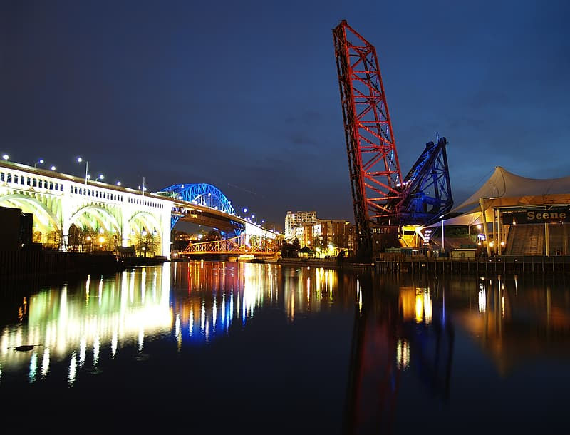 Body of water with bridge during night time