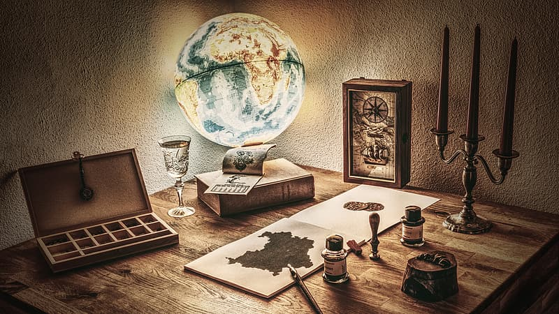 Desk globe beside book