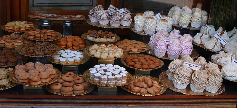 Assorted cup cakes in trays