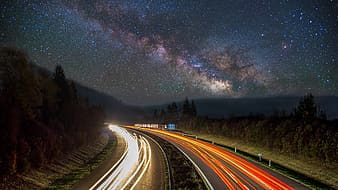 Timelapse photography of cars passing through highway